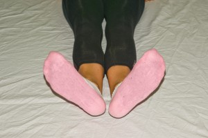 3. Rotate your feet out at the ankles as far as they go without moving your legs